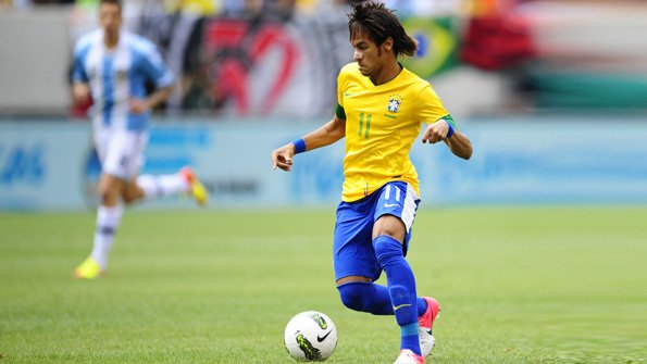 Brazilian player Neymar takes the ball d